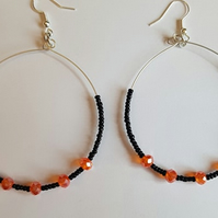 black and orange beaded hoop earrings
