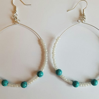 White and blue hoop earrings