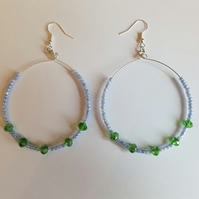 lavender and green beaded hoop earrings