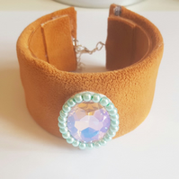 brown up-cycled cuff with pink glass pendent