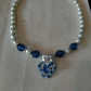 Stunning blue glass and pearl beaded necklace with flower pendant
