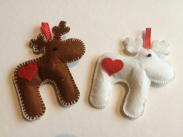 a pair of felt reindeer decorations
