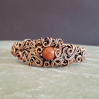 Wire Wrapped Goldstone and Copper Cuff Bracelet