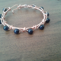Crossover NT copper bangle with  blue goldstones