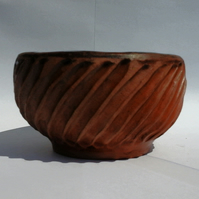 Hand built and carved ceramic bowl in chocolate brown