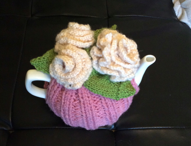 Hand knitted dusty pink teacosy decorated with Ivory roses