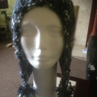 Hand knitted slouch with ear flaps hat, with pom-poms