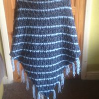 Handknitted shawl, wrap, scarf triangular in shape with toggle fasteners