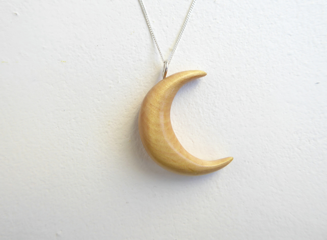Crescent moon pendant necklace hand carved from willow wood