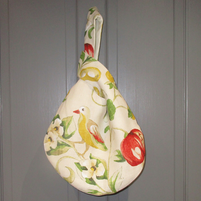 Linen Japanese knot bag in pear and pomegranate design fabric, fully lined