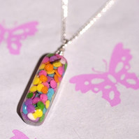 Sprinkle discs lozenge pendant on 16 inch silver plated chain