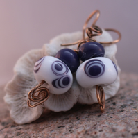 White and purple lampwork bead and bronze earrings