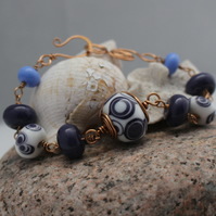 Artisan Lampwork bead and Bronze bracelet in White and Purple