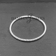 Fine silver hand wrought twist bangle.