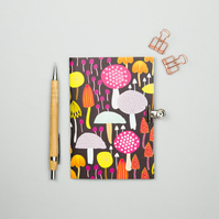 Toadstools and mushrooms pattern notebook A6