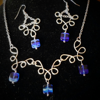 interesting wire shapes with pretty blue beads and matching earrings