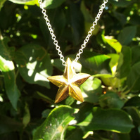 Porcelain gold lustered star necklace on a sterling silver 18'' chain