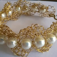 Wire crocheted and white Pearl beads bracelet.