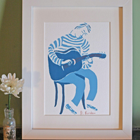 hand-painted framed screenprint of guitar player