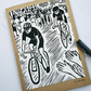 Handmade, hand-printed linoprint father's day card of cyclist.