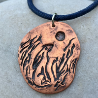 Hare and moon pendant