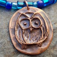 Copper owl necklace with blue glass