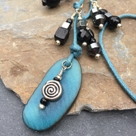 Tagua nut pendant, long necklace, teal and black