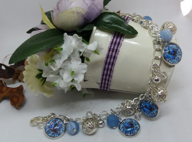Charm bracelet with blue butterfly.