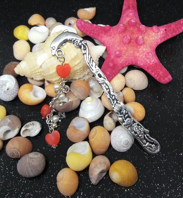 Small dolphin bookmark with shell hearts