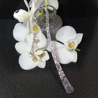 Sunny weather bookmark with golden beads