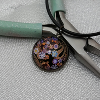 NL106 Paisley style pattern pendant on cord necklace