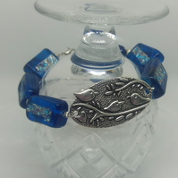 BR116 Blue oblong beads with bird disc bracelet.