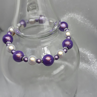 BR262 Shimmering purple and silver miracle beaded bracelet