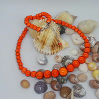 NL32 - Graduated orange miracle bead necklace