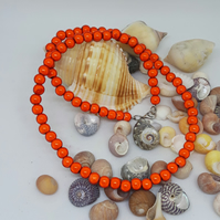 NL33 - Orange miracle bead necklace