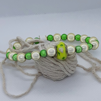 BR369 Yellow and green miracle bead bracelet with glass feature bead