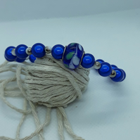 BR371 Blue miracle bead bracelet with glass feature bead