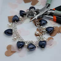 BR388 Blue ceramic heart bracelet with fresh water pearls