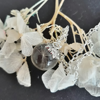 R12. Resin globe necklace with dandelion seed.