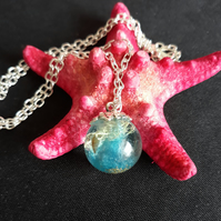R1. Resin seaside globe necklace