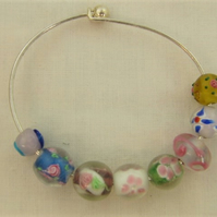 Bracelet Made Using a Selection of Glass Lampwork Beads on a Rigid Base