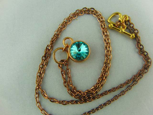 Turquoise Swarovski Crystal Pendant with a Rose Gold Setting and Chain