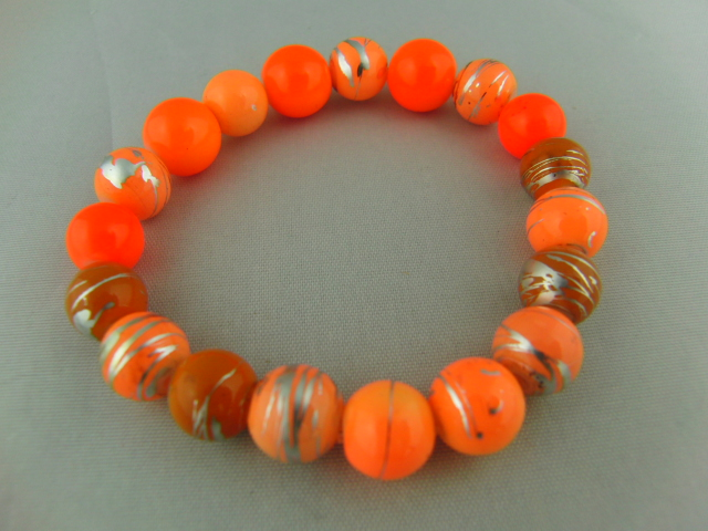 Stretch Beaded Bracelet Made Using Shades of Orange Beads Including Neon Orange