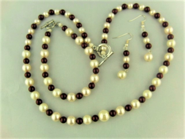 Maroon and Cream Pearl Jewellery Set Comprising a Necklace Bracelet and Earrings