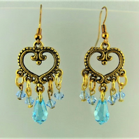 Earrings made with Blue Crystal Beads and a Gold Chandelier Connector