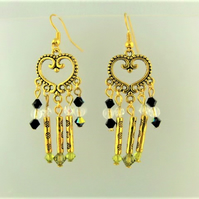 Earrings made with Black Clear and Green Crystals and Gold Plated Tube Beads