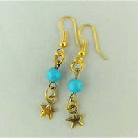 Gold Star Earrings with a Blue Bead For Pierced Ears