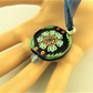 Black Glass Circular Pendant with Painted Multi Coloured Flower Pattern