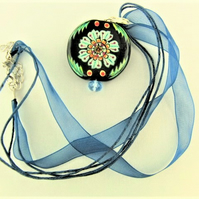 Black Glass Circular Pendant with Painted Multi Coloured Flower