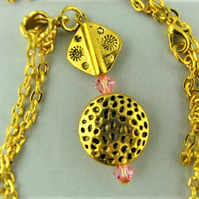 Gold Plated Circle and Diamond Shaped Textured Charm Pendant with Pink Crystals